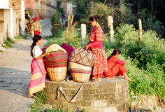 Women of Kathmandu, Nepal. Nepalese working women in colorful clothes with sacks of laundry smiling on a break, Kathmandu, Nepal royalty free stock photos