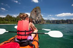 Women are kayaking in the open sea at the Krabi shore, Thailand Stock Photo