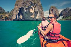 Women are kayaking in the open sea at the Krabi shore, Thailand Stock Photos