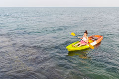 Women kayaking in the sea stock photography