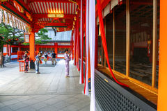 Women in kimono Japanese dress ringing bells praying for good luck Stock Photography