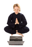 Women in kimono meditation in pose of lotus with laptop Stock Photo