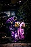 Women in kimono robes in garden