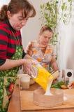 Women on kitchen. Royalty Free Stock Image