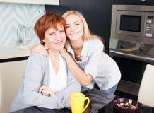 Women on kitchen Stock Image