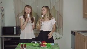 Women on a Kitchen and Talking drinking champagne smiling dance rapid 50fps healthy food. Women Cooking Food on a Kitchen and Talking dance healthy food stock footage