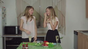 Women on a Kitchen and Talking drinking champagne smiling dance rapid 50fps healthy food. Women Cooking Food on a Kitchen and Talking dancing healthy food stock video footage