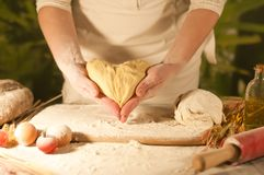 Women baker hands recipe flour  pasta butter, tomato preparation dough and making bread Stock Images