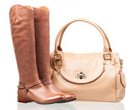 Women knee-high boots and leather bag Stock Photography
