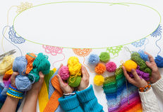 The women knit and crochet colored fabric. View from above. Stock Photos