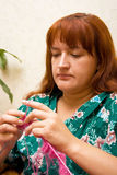 Women knits on spokes 2 Stock Images