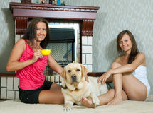Women   with  labrador  in home Royalty Free Stock Image