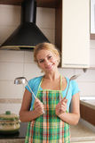 Women with ladle on kitchen royalty free stock image