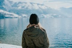 Women by the lake in winter time stock image