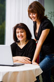 Women with laptop Stock Photography
