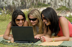 Women and laptop on the beach Stock Photos