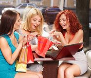 Women at laptop  in a cafe. Royalty Free Stock Photo
