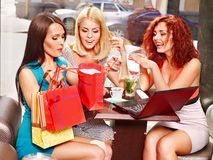Women at laptop  in a cafe. Stock Images