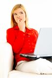 Women with laptop on couch Royalty Free Stock Images