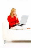 Women with laptop on couch Stock Photo