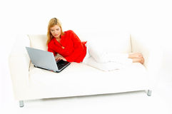 Women with laptop on couch Stock Image