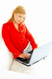 Women with laptop on couch Royalty Free Stock Photos