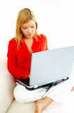 Women with laptop on couch Stock Photos