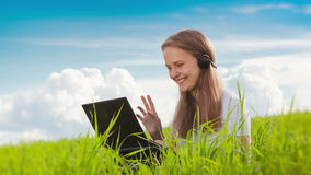 Women With Laptop on Green Meadow stock video