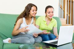 Women with laptop in home interior Stock Images