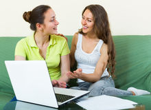Women with laptop in home interior Royalty Free Stock Photography