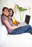 Women with a laptop indoors Stock Images