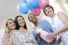 Women With Large Baby Bottle At Baby Shower Stock Image