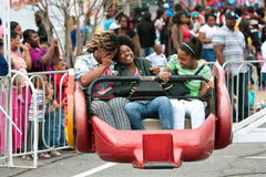 Women Laugh While Riding Carnival Ride royalty free stock images