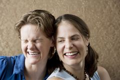 Women Laughing. Portrait of Two Young Women Friends Laughing Royalty Free Stock Images