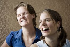 Women Laughing. Portrait of Two Young Women Friends Laughing Stock Photo