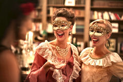 Women laughing a a party. Women laughing at a masquerade party Stock Photography
