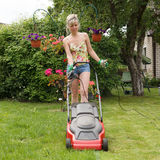 Women with lawn mower Royalty Free Stock Images