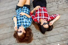 Women laying on boardwalk Stock Photos