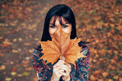Women with leaf in front of face Royalty Free Stock Images