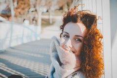 Women Leaning on White Wooden Fence Wearing Gray Furred Top stock photos