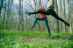 women leaping in forest Royalty Free Stock Images