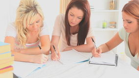 Women learning at a table stock footage