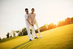 Romantic date on the golf course. Couple learning to play golf Stock Photo