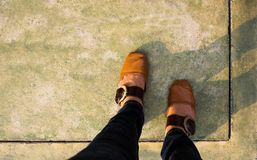 Women with Leather Shoes Steps on Concrete Floor, Top view royalty free stock photos