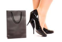 Free Women Legs In Fashion Shoes Near Shopping Bag Stock Image - 12828361