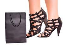 Women legs kick shopping bag Royalty Free Stock Photos