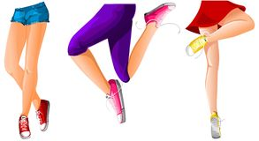 Women legs in sneakers Stock Images