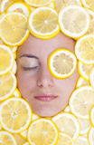 Women with lemons on face. Women with many lemons on face Royalty Free Stock Images