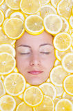Women with lemons on face. Women with many lemons on face Royalty Free Stock Photos