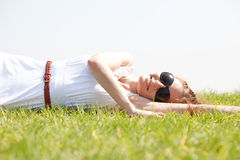 Women lie down on grass Royalty Free Stock Photos